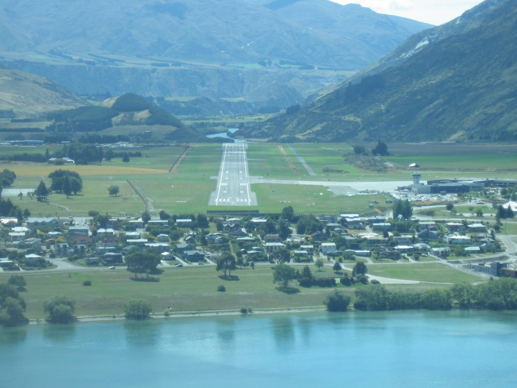 Take off from Queenstown picturesque runway and fly over the rugged landscape